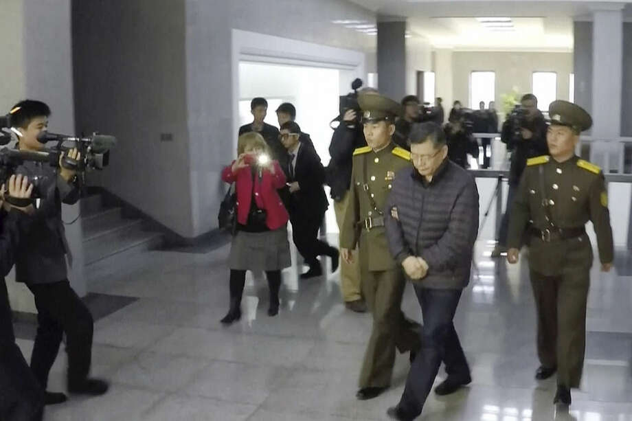 In this image made from video, Hyeon Soo Lim, who pastors the Light Korean Presbyterian Church in Toronto, is escorted to his sentencing in Pyongyang, North Korea, Wednesday, Dec. 16, 2015. North Korea's Supreme Court sentenced a Canadian pastor to life in prison with hard labor on Wednesday for what it called crimes against the state. (AP Photo/APTN)