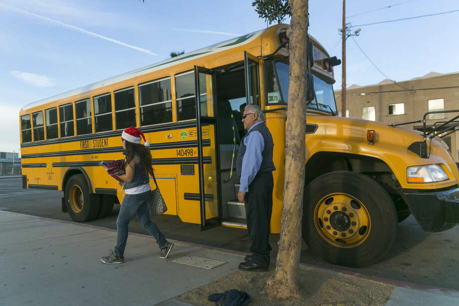 Los Angeles-area students arrive to school at the Edward R. Roybal Learning Center in Los Angeles Wednesday, Dec. 16, 2015. Students are heading back to class a day after an emailed threat triggered a shutdown of the vast Los Angeles Unified School District. The shutdown abruptly closed more than 900 public schools and 187 charter schools across Los Angeles. (AP Photo/Damian Dovarganes)