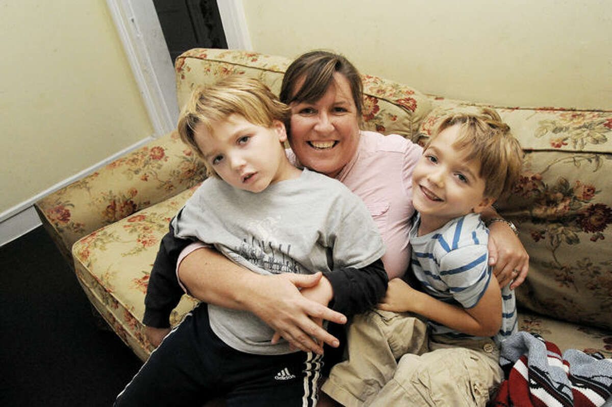 Lindsey Clark with her two six year old sons Miles and Jeremy. A benefit is scheduled for November 5th at Jimmy's Southside Tavern in Darien in support for the twin boys who suffer from Dravet Syndrome, a debilitating and life-threatening form of epilepsy. Hour photo/Matthew Vinci
