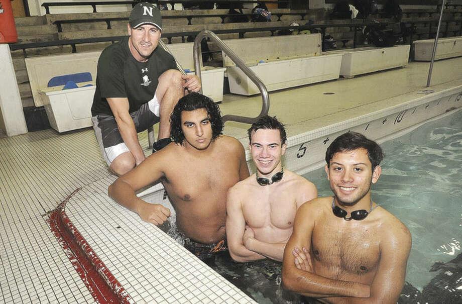 Hour photo/Matthew VinciNorwalk-McMahon boys swim coach, Chris Passamano, left, and captains Nico Roldman, Josh Ramano and Pablo Chajon are preparing for a new season.