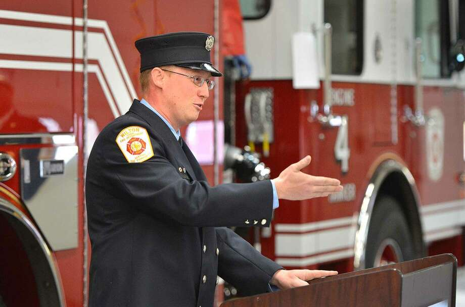 Wilton Firefighter Bill Elliot thanks all involved for their help in getting the departments new fire engine during a ceremony at Fire Headquarters.