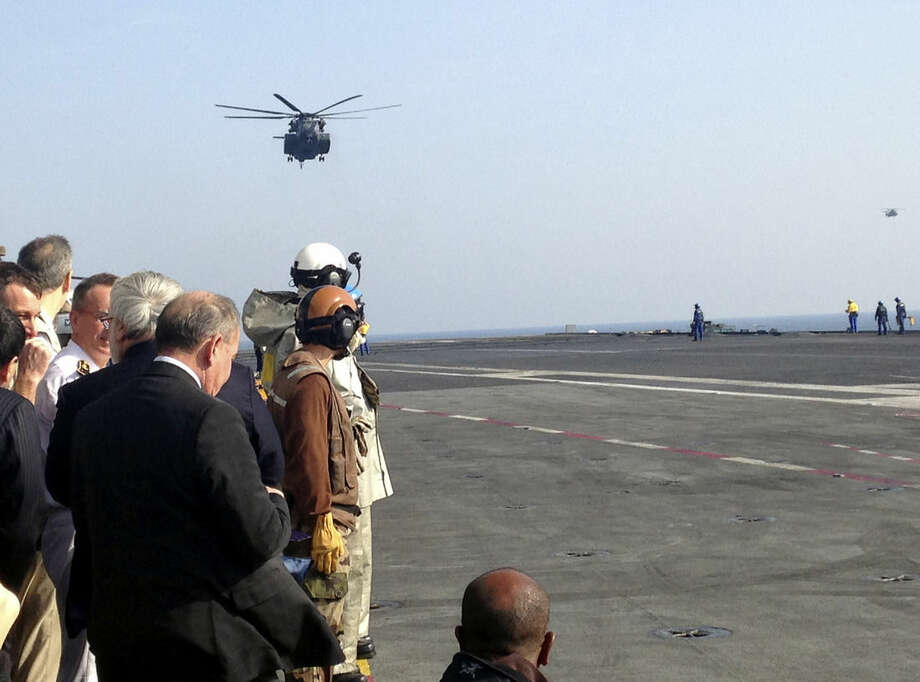 "The helicopter carrying U.S. Secretary of Defense Ash Carter arrives on the French aircraft carrier Charles de Gaulle in the Persian Gulf Saturday, Dec. 19, 2015. The American airstrike that may have killed a number of Iraqi soldiers on Friday seems to be ""a mistake that involved both sides,"" Carter said Saturday. He called Iraqi Prime Minister Haider al-Abadi to express condolences. (AP Photo/Lolita Baldor)"
