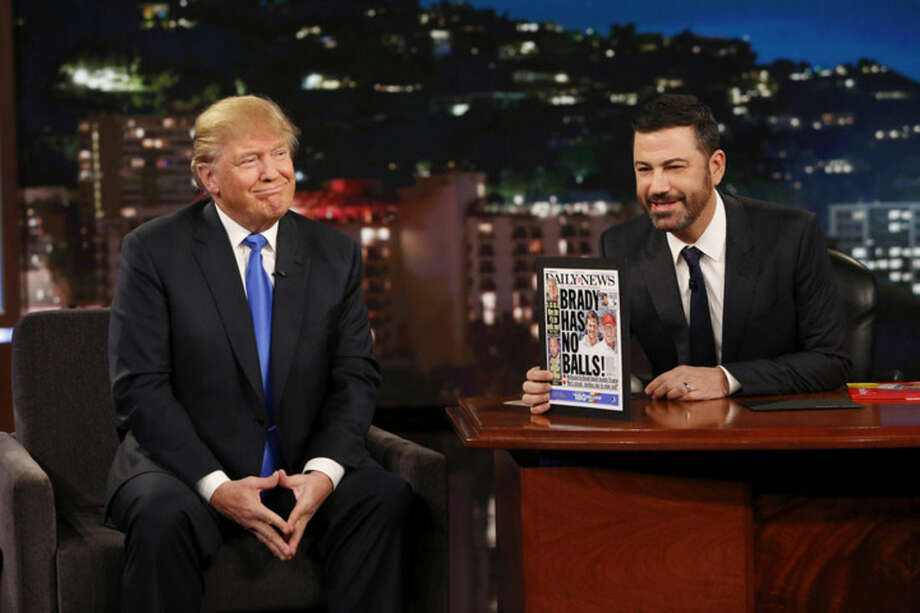 "This photo provided by ABC shows guest Republican Presidential candidate Donald Trump, left, with host Jimmy Kimmel, on ""Jimmy Kimmel Live"" on Wednesday, Dec. 16, 2015, in Los Angeles. The ABC show airs every weeknight, 11:35 p.m. - 12:41 a.m., ET. (Randy Holmes/ABC via AP)"
