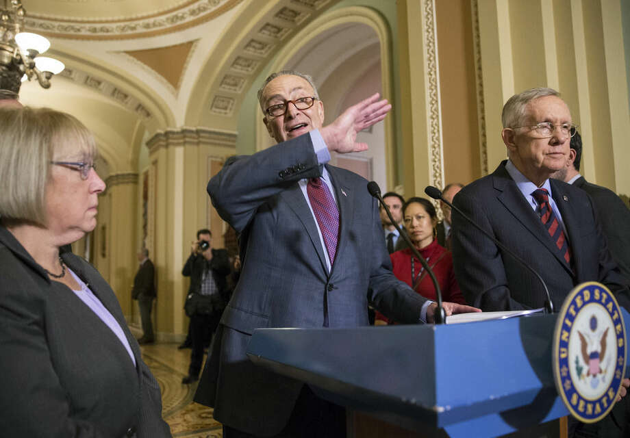 FILE - In this Dec. 8, 2015, file photo, Sen. Chuck Schumer, D-N.Y., joined by Sen. Patty Murray, D-Wash., left, and Senate Minority Leader Harry Reid, D-Nev., right, criticizes Republicans for not doing enough to stop gun violence, during a news conference on Capitol Hill in Washington. (AP Photo/J. Scott Applewhite, File)
