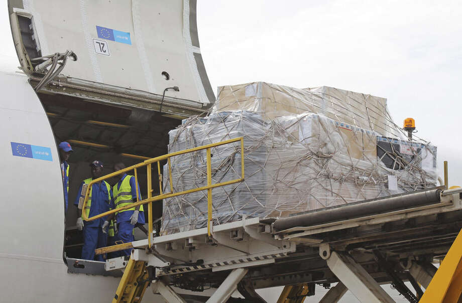"In this photo taken Wednesday, Oct. 29, 2014, aid is offloaded to be used in the fight of the Ebola virus, as it arrives by air from America at the airport in Conakry, Guinea. No African countries are on the United Nations list of contributors to fight the Ebola epidemic, and angry legislators from Sierra Leone and Liberia got up to protest at a session on peace and security at the Pan-African Parliament in South Africa last ""They said as far as they are concerned, nobody wants to talk about Ebola,"" said Jeggan Grey-Johnson, a governance expert. (AP Photo/ Youssouf Bah)"