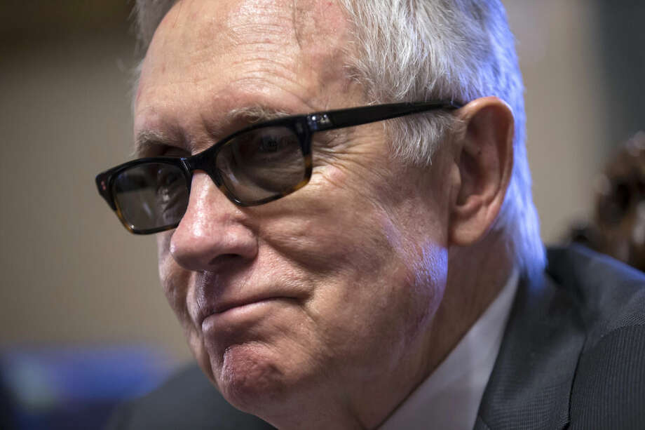 In this Dec. 17, 2015, photo, Senate Minority Leader Harry Reid of Nev. talks about the compromise process of working on the $1.1 trillion omnibus spending bill with the Republicans holding the majority in Congress during an interview with The Associated Press in his leadership office on Capitol Hill in Washington. (AP Photo/J. Scott Applewhite)