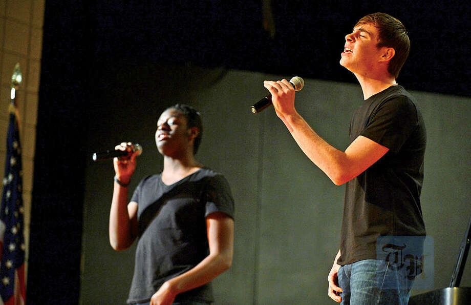 Hour photo / Erik Trautmann Brandon Wolfe and Ari Berkun sing a Christmas song during the 1st annual Phi Theta Kappa Honor Society Winterfest at Norwalk Community College Saturday.