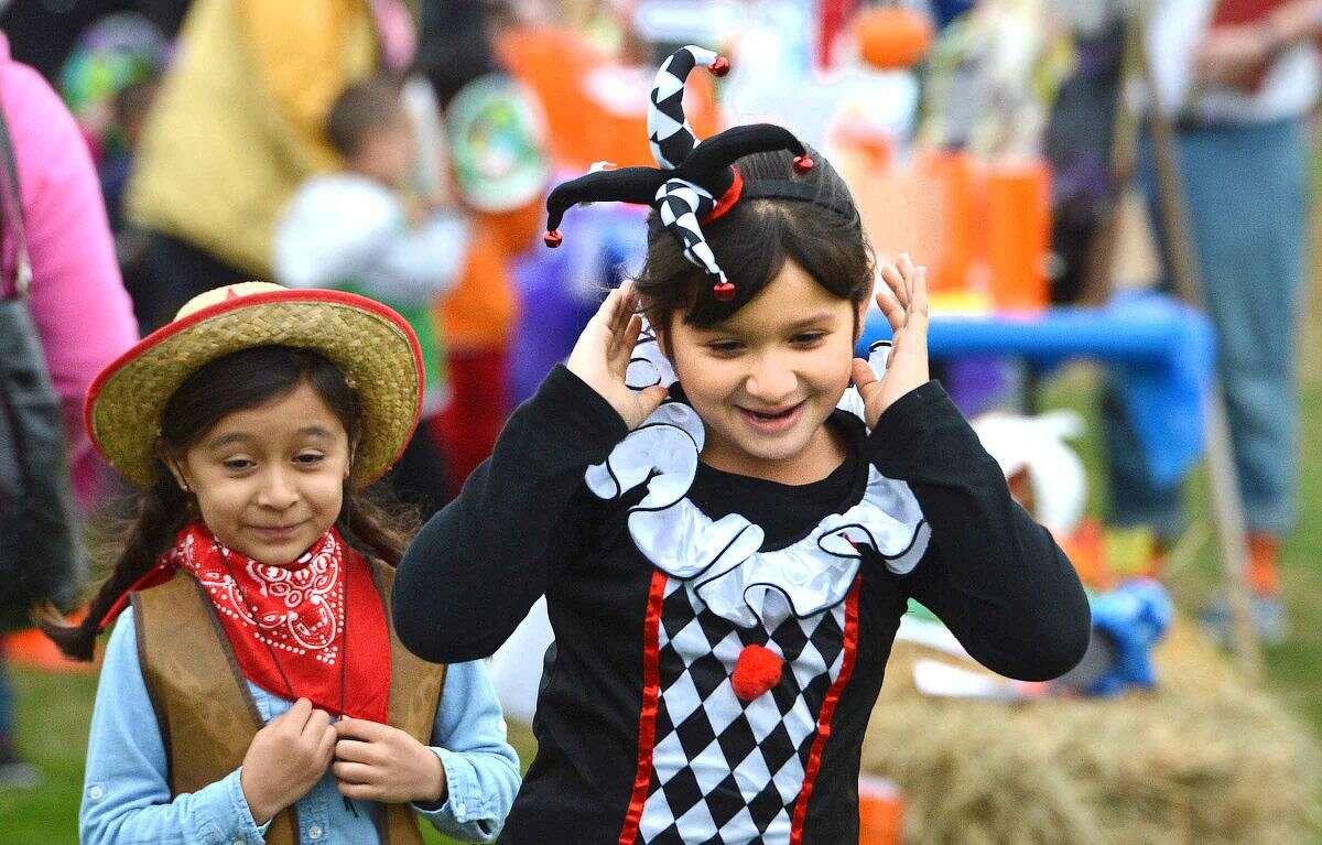 Hour Photo/Alex von Kleydorff 2nd Grader Camila Roldan holds on to her Jester hat while running to catch the Halloween parade at Brookside School