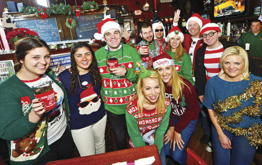 Hour photo / Erik TrautmannClockwise from left; Sarah Renkoski, Michaela Murphy, Thomas Cornwell, Joe Ianneillo, Michael McCarthy, Ashley Keller, Wit Cooper, Jeff Klein, Teah Maunula, Emily O'Hare and Kelly Ochman, have a drink at Donovan's during the SoNo Santa Crawl pub crawl in South Norwalk Saturday.
