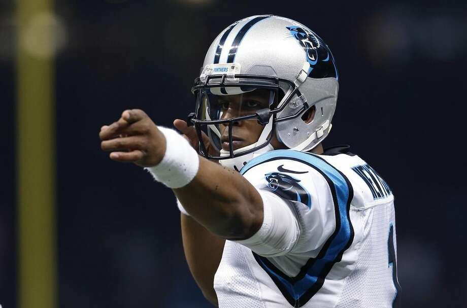 FILE - In this Dec. 6, 2015, file photo, Carolina Panthers quarterback Cam Newton (1) reacts in the first half of an NFL football game against the New Orleans Saints, in New Orleans. The Panthers (13-0) play the New York Giants (6-7) on Sunday, Dec. 20, 2015, in East Rutherford, N.J. (AP Photo/Jonathan Bachman, File)