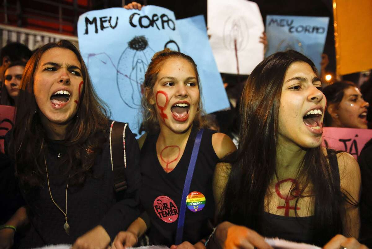 Women shout slogans as they march during a protest against the gang rape of a 16-year-old girl that occurred in Rio de Janeiro last month, in Sao Paulo, Brazil, Wednesday, June 8, 2016. A group of about 500 called out against the rape culture and the increase of sexual abuse against them. (AP Photo/Andre Penner)
