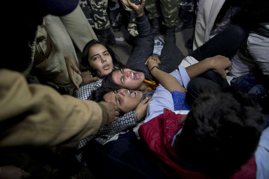Indian youth shout slogans as they are detained by police during a protest against the release of a juvenile convicted in the fatal 2012 gang rape that shook the country in New Delhi, India, Sunday, Dec.20, 2015. The convict, who was short of his 18th birthday at the time of the crime, was to finish his three-year term in a reform home on Sunday. Several activists and politicians have demanded that he not be released until it can be proven that he has been reformed. (AP Photo /Tsering Topgyal)