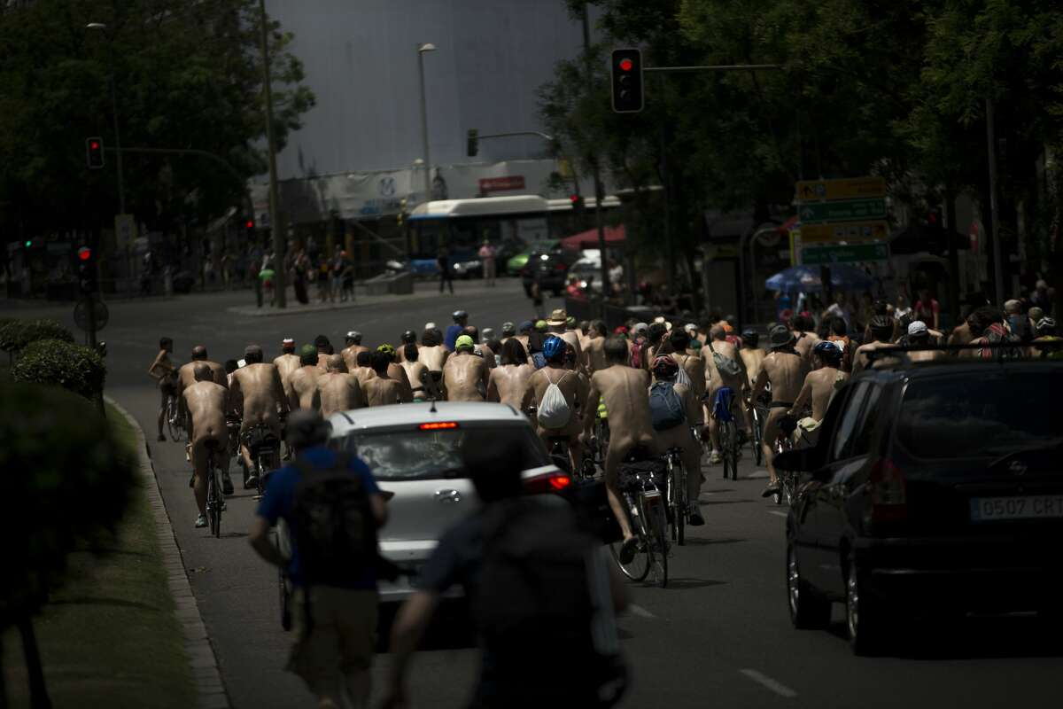 Naked people ride their bikes during a bike tour parade in Madrid, Saturday, June 11, 2016. The cyclists protested the habitual traffic jams in the city, automobiles pollution and better facilities for bike riders in the city. (AP Photo/Francisco Seco)