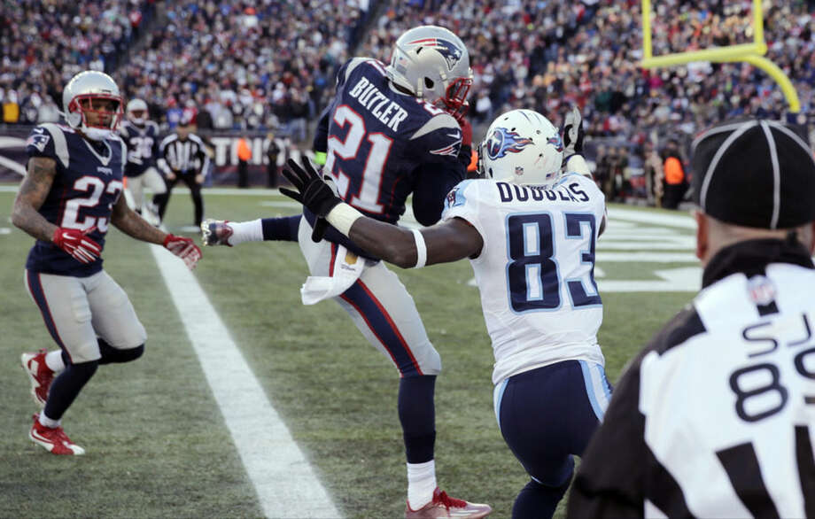 New England Patriots safety Malcolm Butler (21) intercepts a pass in front of Tennessee Titans wide receiver Harry Douglas (83) in the second half of an NFL football game, Sunday, Dec. 20, 2015, in Foxborough, Mass. (AP Photo/Charles Krupa)