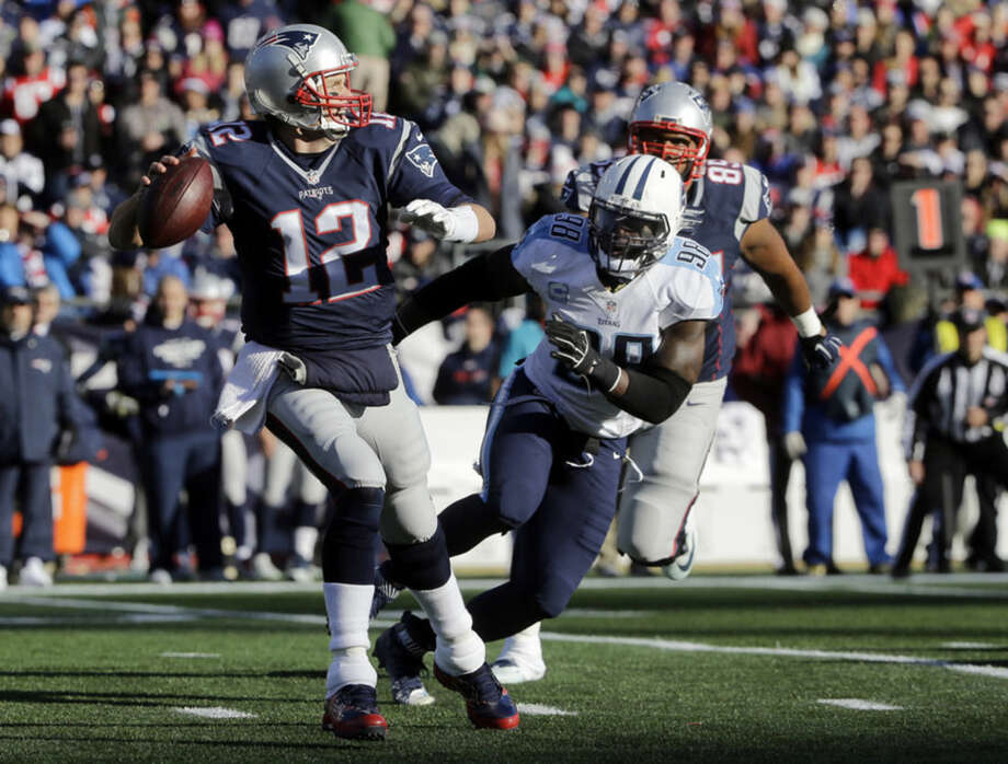 New England Patriots quarterback Tom Brady (12) passes against pressure from Tennessee Titans linebacker Brian Orakpo (98) in the first half of an NFL football game, Sunday, Dec. 20, 2015, in Foxborough, Mass. (AP Photo/Steven Senne)