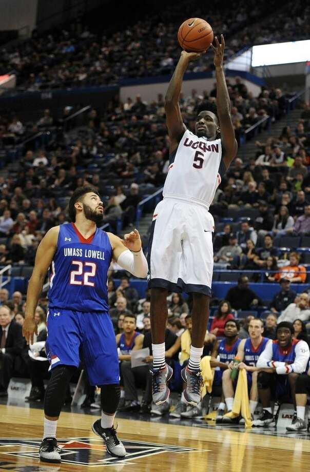 Connecticut's Daniel Hamilton shoots over UMass-Lowell's Matt Harris, left, in the first half of an NCAA college basketball game, Sunday, Dec. 20, 2015, in Hartford, Conn. (AP Photo/Jessica Hill)