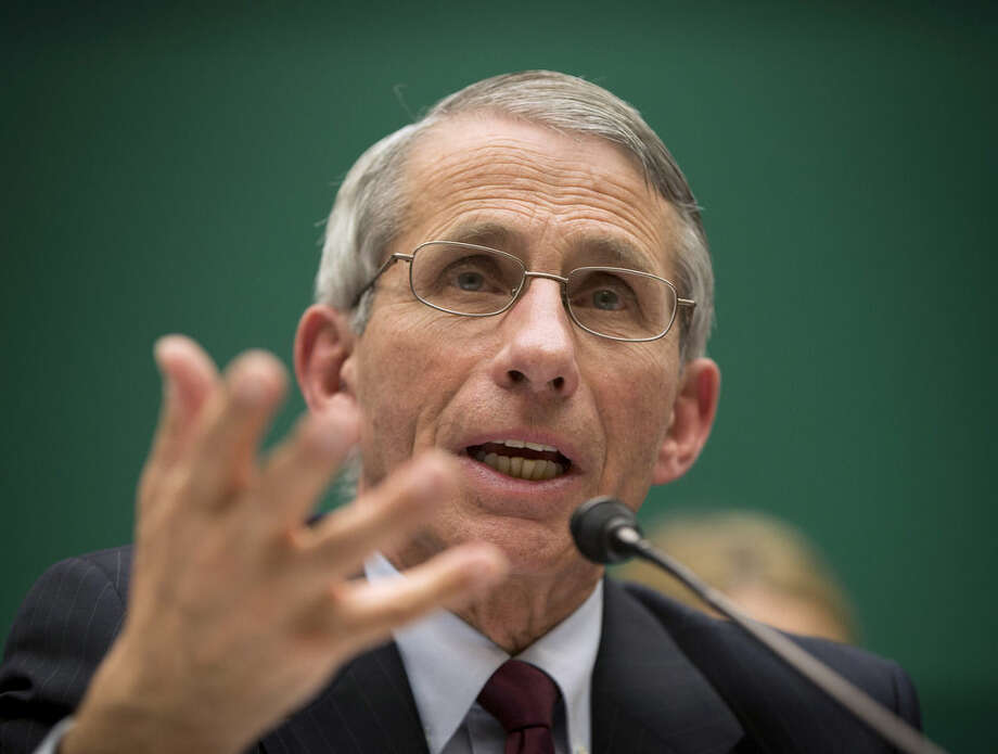 FILE - In this Oct. 16, 2014 file photo, Dr. Anthony Fauci, director of The National Institute of Allergy and Infectious Diseases, testifies before the The House Energy and Commerce Committee's subcommittee on Oversight and Investigations on Capitol Hill in Washington. The gulf between politicians and scientists over Ebola widened on Sunday, Oct. 26, 2014 as the nation's top infectious-disease expert warned that the mandatory, 21-day quarantining of medical workers returning from West Africa is unnecessary and could discourage volunteers from traveling to the danger zone. (AP Photo/Pablo Martinez Monsivais, File)