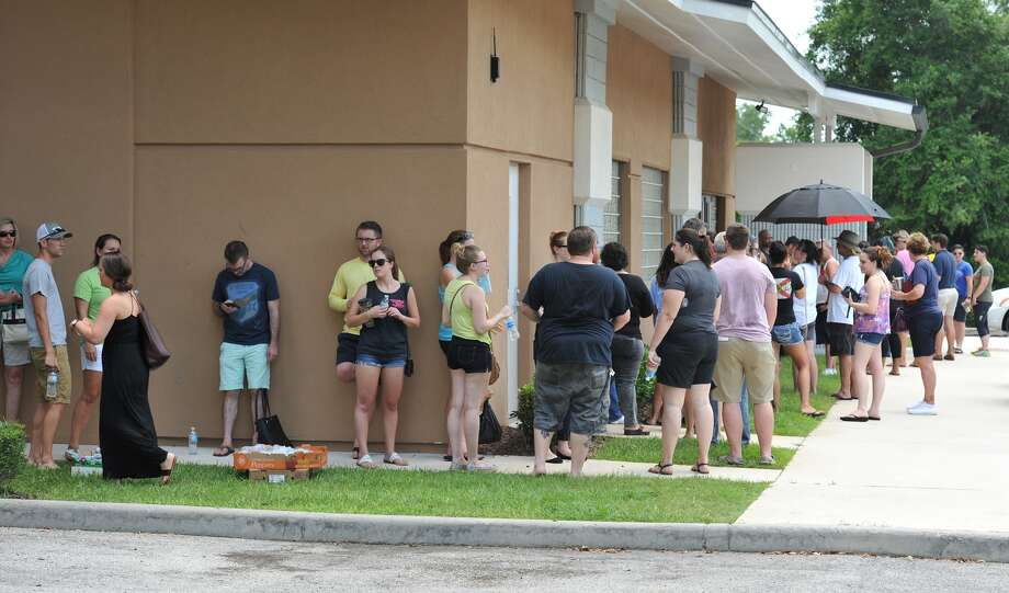 Potential blood donors line up outside the oneblood facility on Beach Blvd. In Jacksonville, Fla., Sunday, June 12, 2016, to help the victims from the shooting at a nightclub inOrlando. A gunman wielding an assault-type rifle and a handgun opened fire inside a gay nightclub early Sunday, killing at least 50 people before dying in a gunfight with SWAT officers, police said. It was the worst mass shooting in American history. (Bob Self/The Florida Times-Union via AP) Photo: (Bob Self/The Florida Times-Union Via AP)
