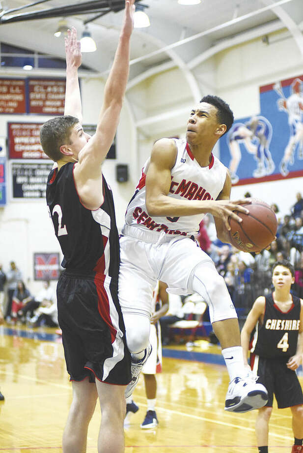 Hour photo/John NashBrien McMahon's Matt Saint-Louis, right, goes up and makes contact with Cheshire's Heath Post during the first half of Monday's season-opening game in Norwalk.