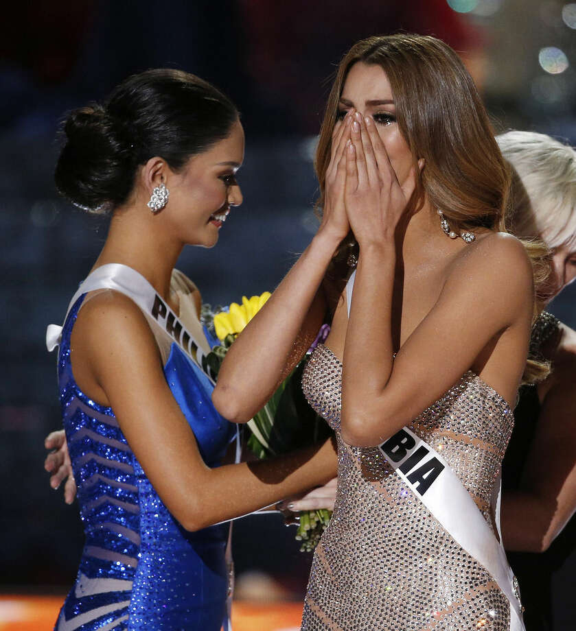 Miss Colombia Ariadna Gutierrez, right, reacts as the announcer incorrectly names her the new Miss Universe next to Miss Philippines Pia Alonzo Wurtzbach, left, at the Miss Universe pageant on Sunday, Dec. 20, 2015, in Las Vegas. Wurtzbach was later given the crown after an announcing error. (AP Photo/John Locher)