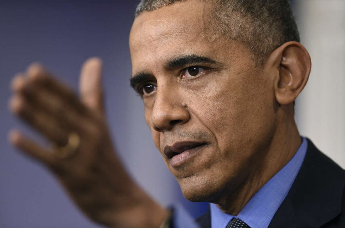 President Barack Obama speaks during a news conference in the Brady Press Briefing room at the White House in Washington, Friday, Dec. 18, 2015. (AP Photo/Susan Walsh)