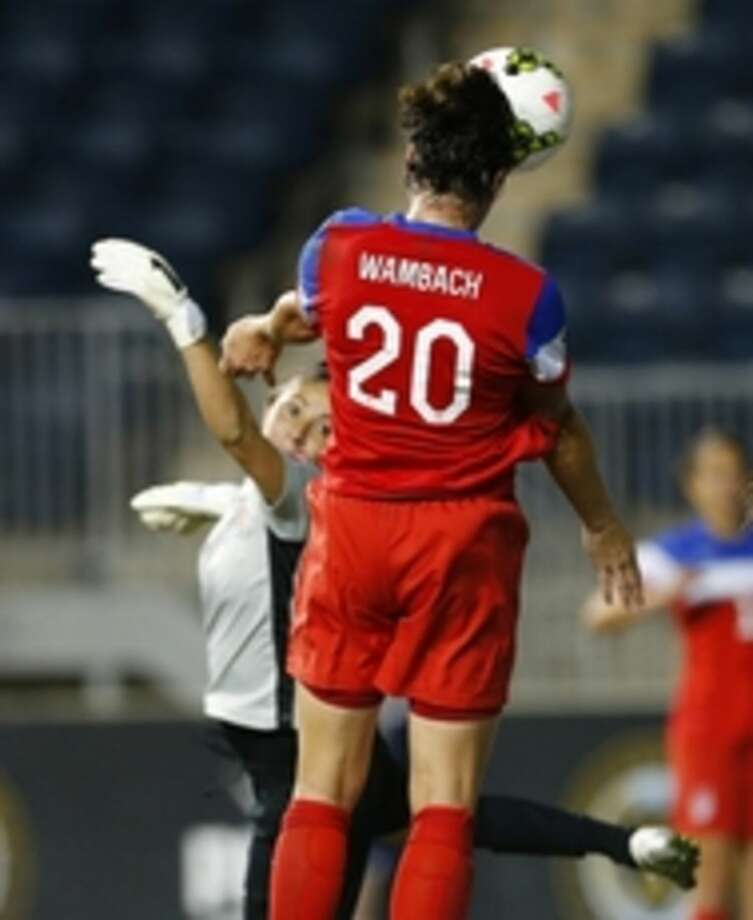 United States forward Abby Wambach (20) heads the ball past Costa Rica goalkeeper Dinnia Diaz for a goal in the first half during the CONCACAF championship soccer match in Chester, Pa., Sunday, Oct. 26, 2014. The United States defeated Costa Rica 6-0. (AP Photo/Rich Schultz)