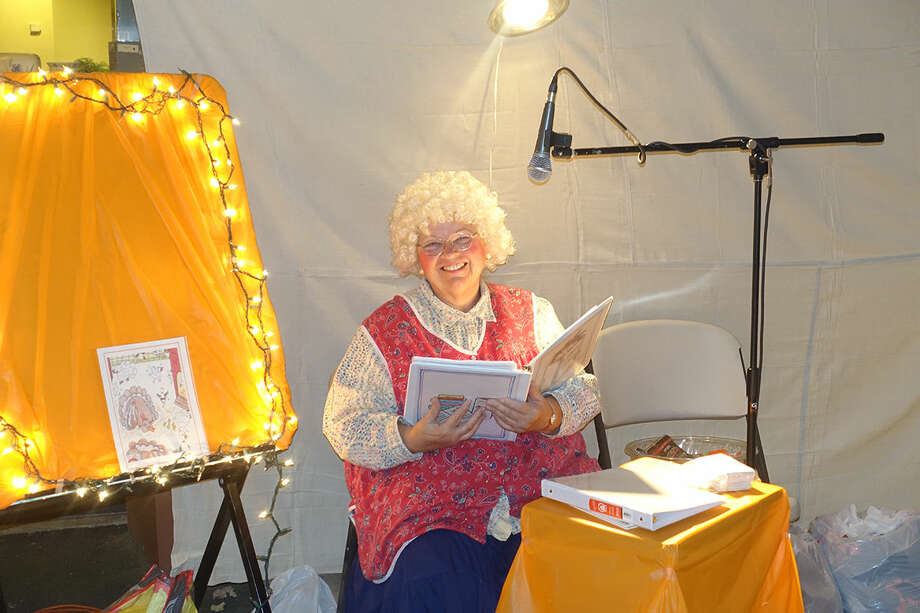Diane Kalnasky, of Norwalk, dressed as Grannie Grace, held a story time for children with stories she wrote and illustrated at Word Alive Bible Church's Trunk or Treat celebration. Hour Photo/Korey Wilson