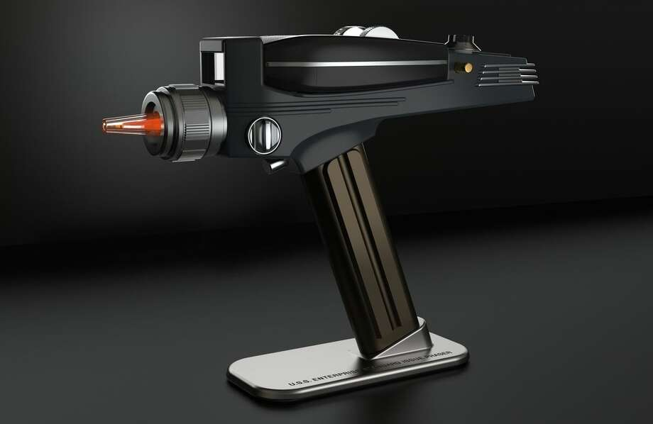 This undated photo provided by The Wand Company shows the Star Trek Phaser Remote Replica. Whether you're shopping for a Trekkie, a tech savvy fisherman or a paranoid chef, gadget gifts abound this year. (The Wand Company via AP)