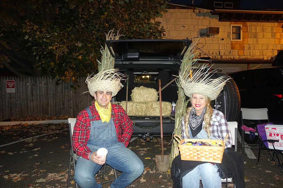 James Kassimis and Lauren Vasale in farmer costumes at Word Alive Bible Church's Trunk or Treat Halloween celebration. Hour Photo/Korey Wilson