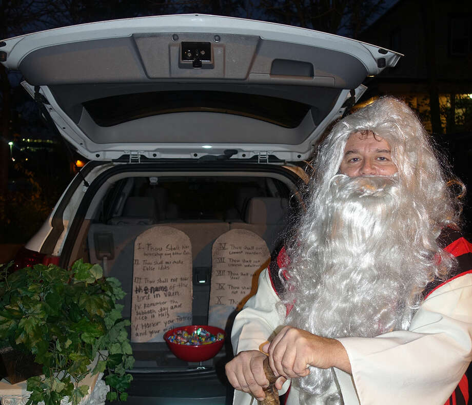 Hour photo/Korey Wilson Rev. Artie Kassimis of Word Alive Bible Church dressed as Moses decorated his trunk with candy and the Ten Commandments at Trunk or Treat celebration.