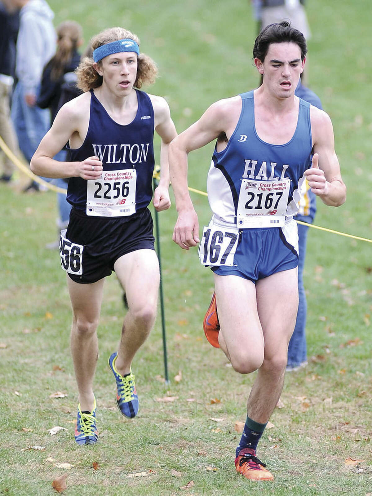 Hour photo/John Nash Wilton's Spencer Brown, left, tries his best to stay with Hall's Ari Klau as the two kick to the finish in Friday's State Open Cross Country meet at Wickham Park in Manchester. Klau finished second and Brown was third behind race winner Alex Ostberg of Darien.