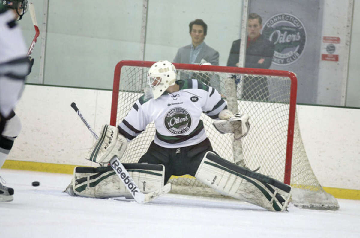 Hour Photo / Danielle Calloway Oilers goalie Chris Bastone makes a save during a game against Vermont at the SoNo Ice House in Norwalk Saturday afternoon.