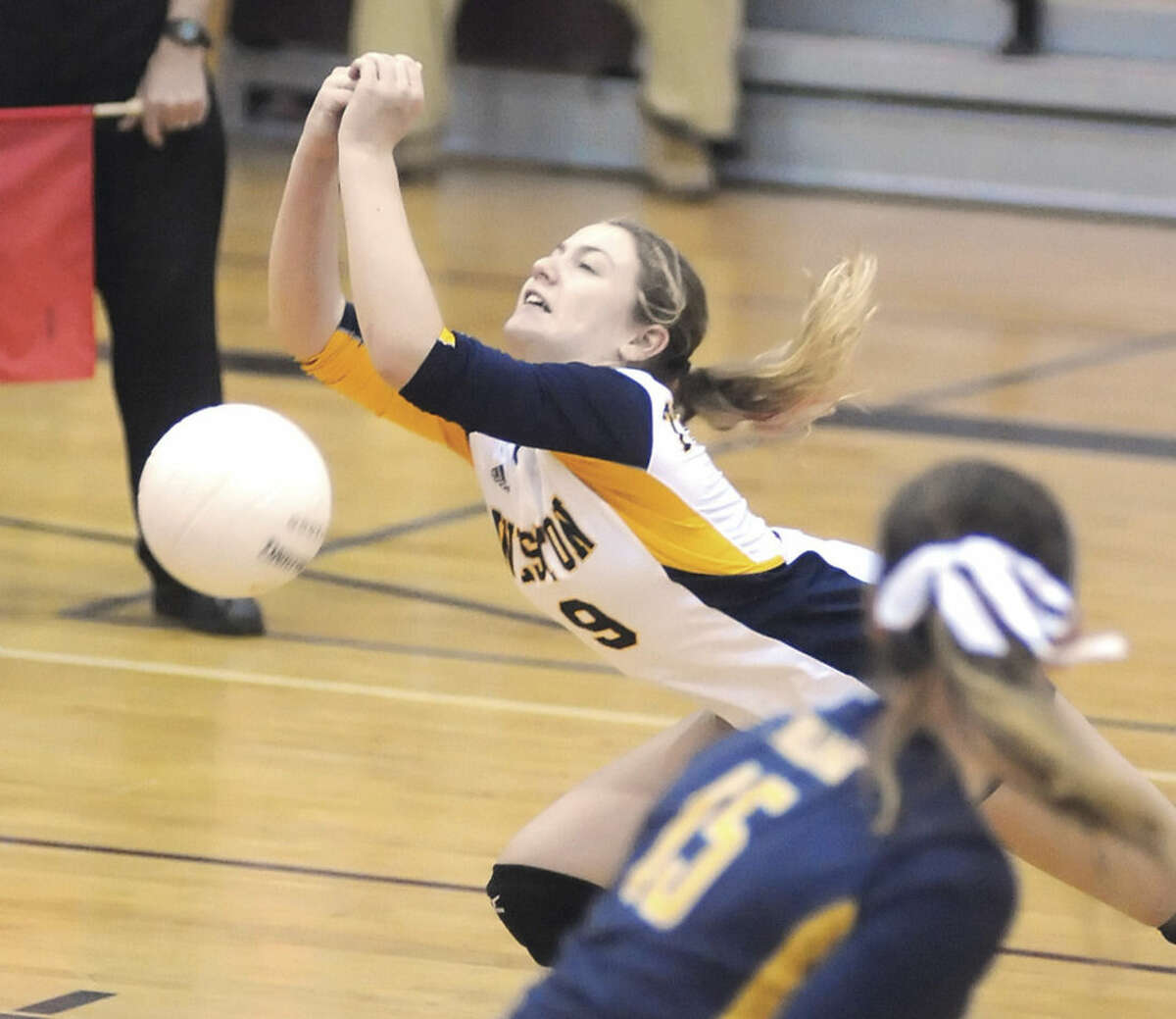 Hour photo/John Nash Weston's Melissa Welsh, rear, can't come up with a dig as Trojans libero Olivia Donnelly looks on during Saturday night's SWC Championship game in Bethel. Joel Barlow defeated Weston, 3-1.