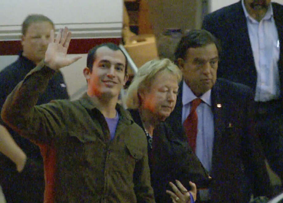 This image taken from a video shows Marine Sgt. Andrew Tahmooressi waving after arriving in Miami on Saturday, Nov. 1, 2014 in Weston, Fla. Tahmooressi is back home after a Mexican judge ordered his release from jail, where he spent eight months for crossing the border with loaded guns. Family spokesman Jon Franks told reporters that Tahmooressi arrived at a South Florida airport about 6 a.m. Saturday. Franks said Tahmooressi was resting with his family at their home suburban Weston, Fla. (AP Photo/Raul Torres) MANDATORY CREDIT