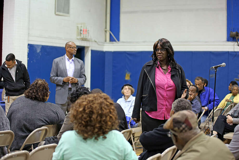 Patricia Billie Miller speaks in Stamford Thursday evening during a public community meeting in the Yerwood Center's gymnasium hosted by Yerwood Community Alliance, Inc. Boards of Directors . Hour Photo / Danielle Calloway