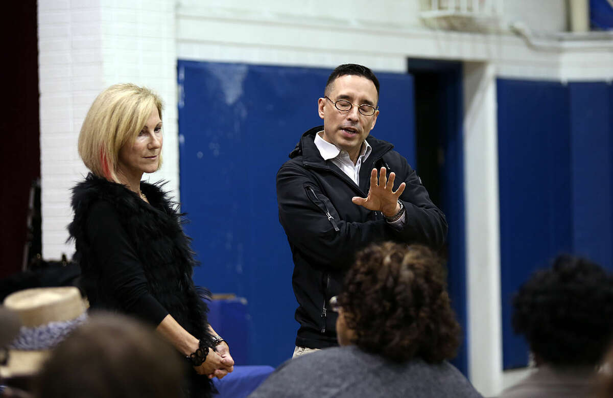 Fernando Alvarez speaks in Stamford Thursday evening during a public community meeting in the Yerwood Center's gymnasium hosted by Yerwood Community Alliance, Inc. Boards of Directors . Hour Photo / Danielle Calloway