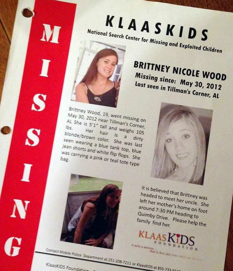 This Oct. 21, 2014, photo shows a flier about missing teenager Brittney Wood at her stepmother's home in Mobile, Ala. The teen hasn't been seen since May 2012 and is presumed dead, but 11 relatives and family friends have since been arrested as members of an alleged ring that swapped children for sex. Authorities say Wood could have been a key witness. (AP Photo/Jay Reeves)