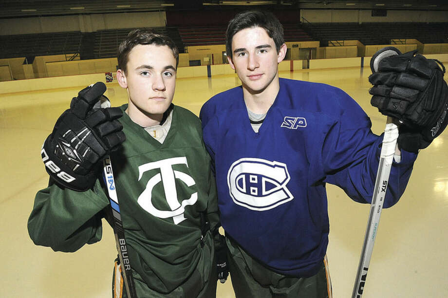 Photo by Matthew VinciTrinity Catholic ice hockey captains for the winter season include, from left, Connor Scanlan and Daniel Bernavo.