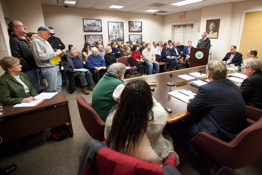Residents sit in on a packed room during the Wilton Board of Selectmen meeting discussing the Miller-Driscoll renovation project.