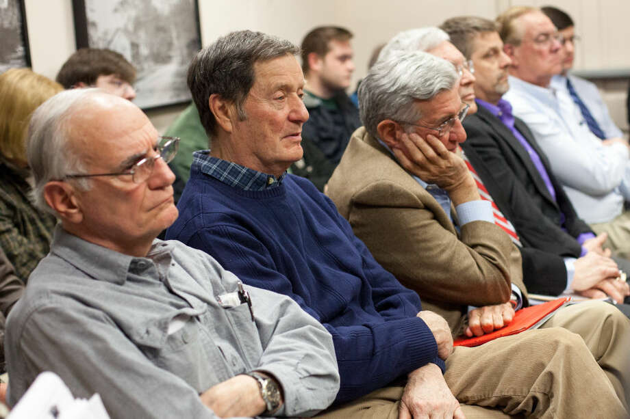 Wilton residents listen during the Board of Selectmen meeting discussing the Miller-Driscoll renovation project Tuesday night.