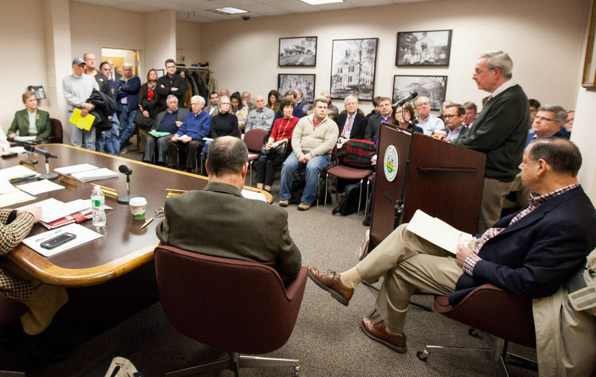 Residents listen in on a packed room during the Wilton Board of Selectmen meeting discussing the Miller-Driscoll renovation project Tuesday.