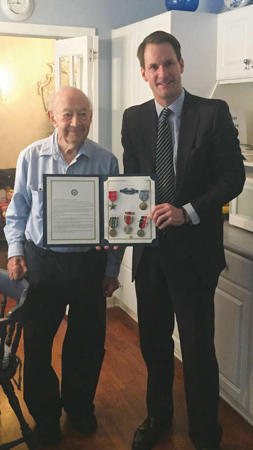 Congressman Jim Himes presents Stamford resident Anthony Viesto with an array of medals earned as an infantryman in the U.S. Army during World War II.