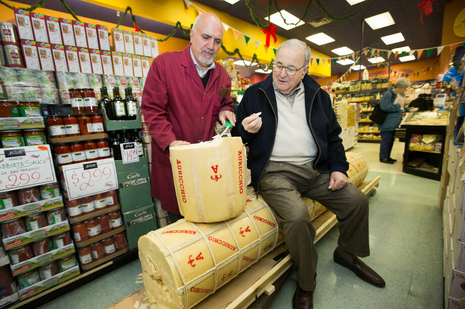 Anthony LoFrisco, 82, (right) seen here with Joe Nicastro, traveled from Wilton to Ottawa, Canada to sample a 1,000-pound provolone cheese on Dec. 1.