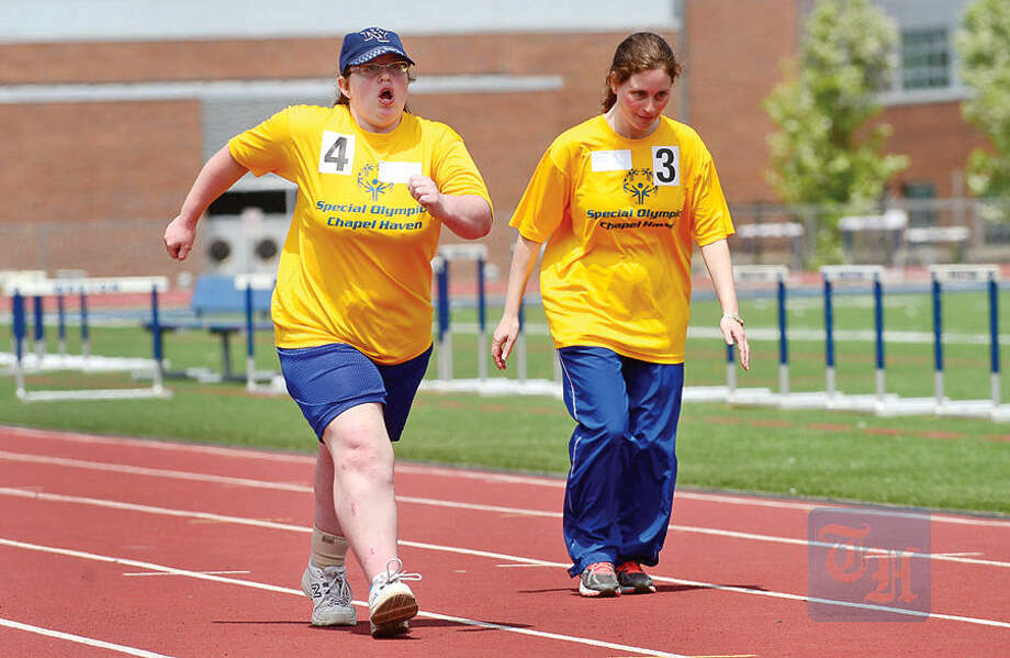 Hour photo / Erik Trautmann Megan Faitell and Tracy Miller racein the 400m Walk during the Special Olympics Connecticut 2015 Southern Time Trials at Weston High and Middle Schools Saturday.