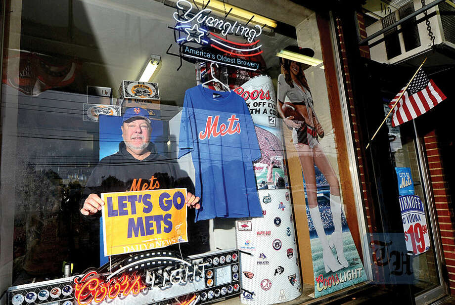 Hour photo / Erik Trautmann Bob Mercede, the owner of the New Canaan Ave Liquors, is a big Mets fans and his store is decorated like a sports shrine, not just for the World Series but year round with a lot of Mets paraphenalia as well as other sports teams represented.