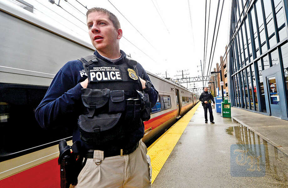 Hour photo / Erik Trautmann Department of Homeland Security agents, the TSA, MTA and Norwalk police on routine patrol at the South Norwalk train station Wednesday morning.