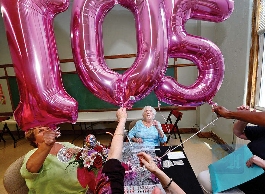 Hour photo / Erik Trautmann Doris Pollard, who plays bridge weekly at the Norwalk Senior Center, celebrates her 105th birthday with her card partners and Center staff Tuesday.
