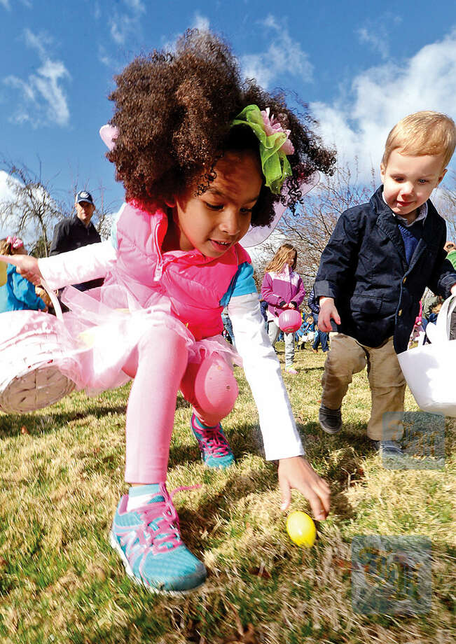 Hour photo / Erik Trautmann Keira Penn, 5, participates in The Rowayton Community Association's annual Easter Egg Hunt Saturday at the Rowayton Community Center.