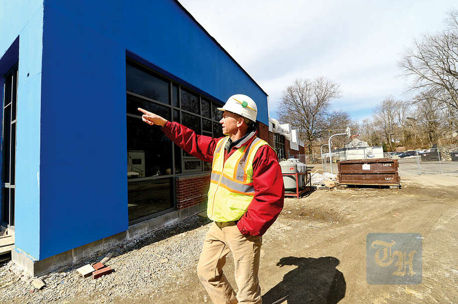 Hour photo / Erik Trautmann Senior Project Manager at A.P. Construction Frank Fazekas outlines major rennovation of Rowayton Elementary School that are well underway. A.P. Construction is racing to be finished in time for fall classes.