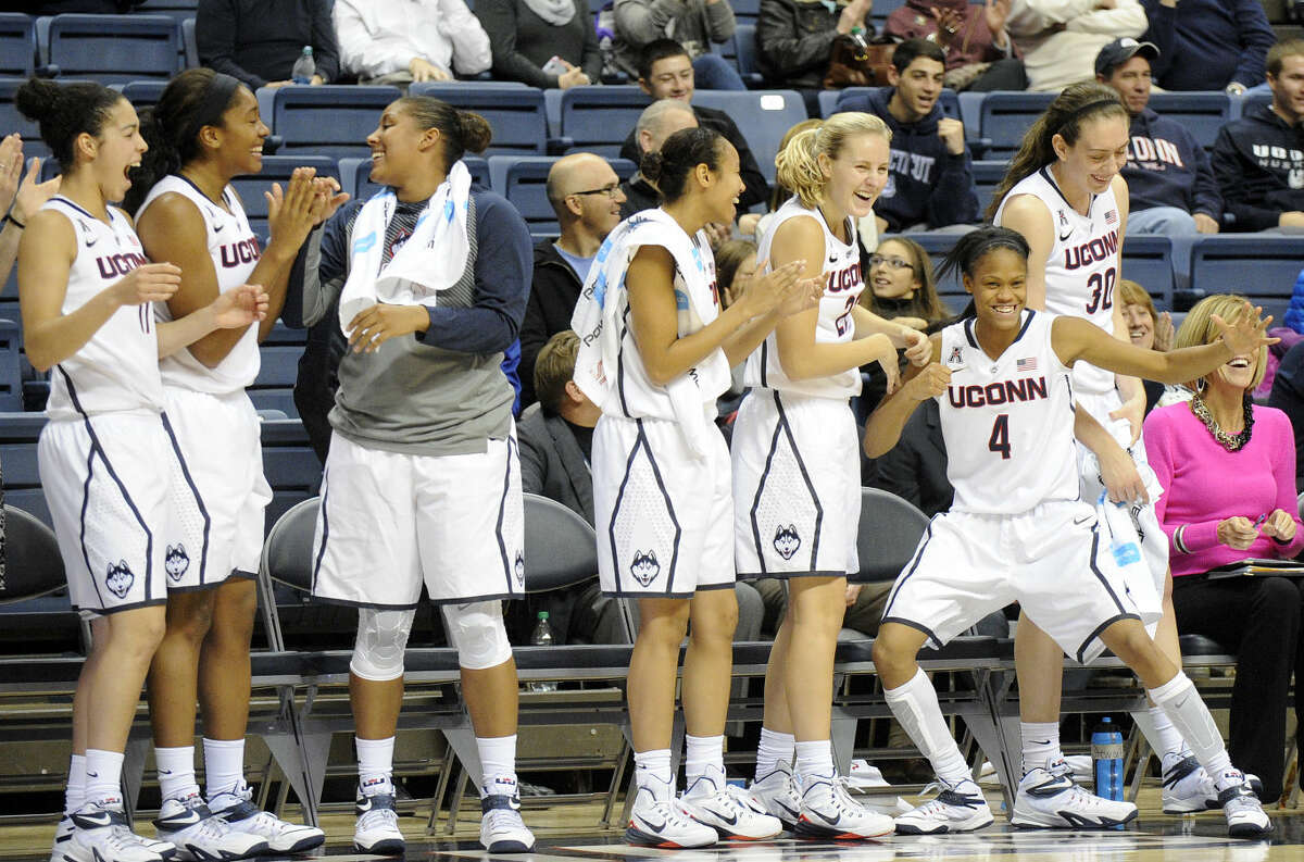 Members of Connecticut's women's basketball team celebrate during during the second half of a NCAA women's college basketball game against West Chester in Storrs, Conn., on Sunday, Nov. 2, 2014. Connecticut won the game 115-26. (AP Photo/Fred Beckham)